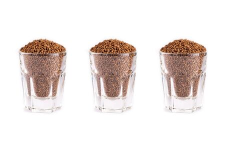 Close up organic Perilla seed and glass on white background. Health food concept.