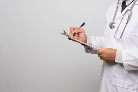 Doctor holding clipboard with sheet of paper. Doctor and stethoscope. Health care concept. Imagens