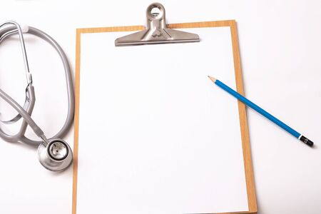 Medical concept : stethoscope on clipboard and pencil with white background Imagens - 134200002