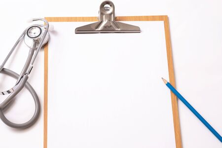 Medical concept : stethoscope on clipboard and pencil with white background Imagens - 134200004