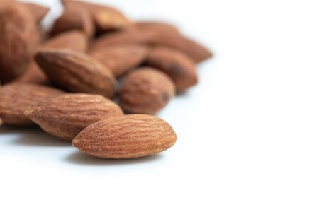 Flavored almonds on white background.
