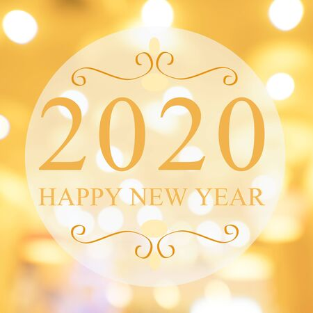 Happy New Year 2020 year on beautiful blur background shopping mall and bokeh. Gold tone.