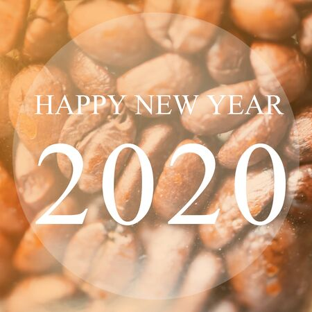 Happy New Year 2020 year on roasted coffee beans background, Brown tone.