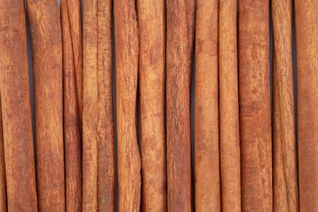Top view cinnamon sticks for background.
