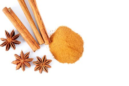 Star anise, Cinnamon sticks and powder isolated on white background. Imagens