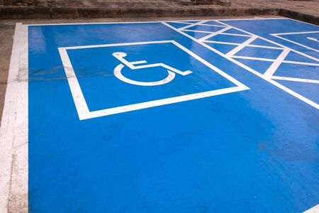 Logos for disabled on parking. handicap parking place sign in Thailand. Imagens