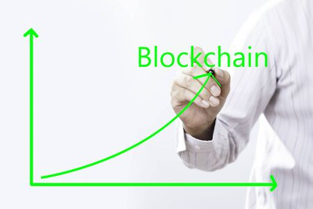 Blockchain Text With Businessman Hand Point On Virtual Graph Green line.