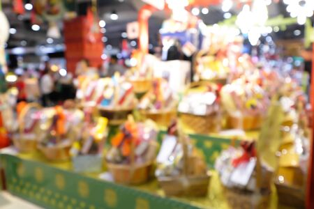 Blurred fresh fruits in a basket at shopping mall. Imagens