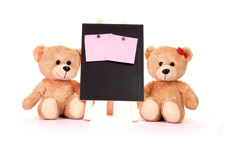 Teddy bear and post-it notes with blackboard on a white background Valentine concepts and love.