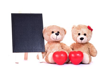 Teddy bears and red heart with blackboard on a white background. Valentines and love concept.