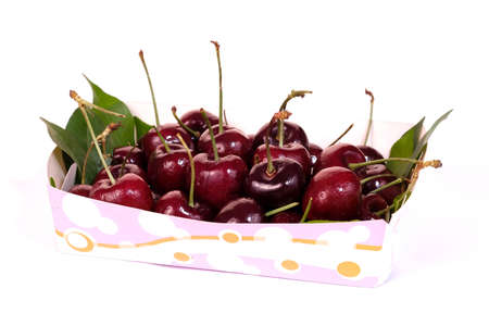 Texture of cherry in paper plate isolated on white background. Sweet fresh cherry