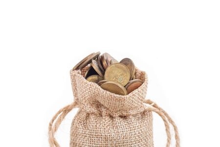 Money bags and coins on white background.Time to invest, time value for money, family planning, money saving, finance saving and investment concept.