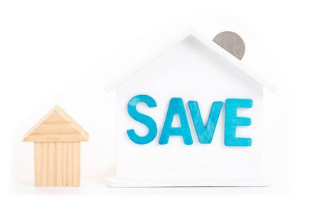 Save word on house is white Piggy bank with coins on white background.Time to invest, real estate and property concept. Finance saving and investment concept.