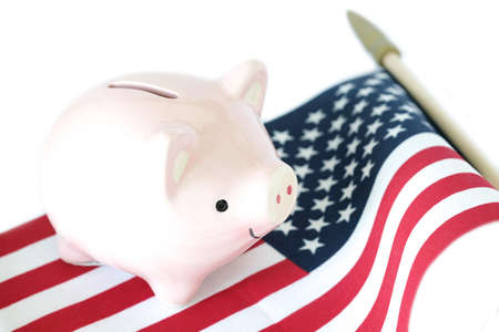 Piggy bank on American flag on white background. Economic condition concept. Stok Fotoğraf