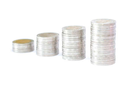 Coins stacks on white background. Saving money concept.