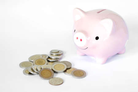 Saving money concept, Piggy bank and coins stacks on white background. Stock fotó