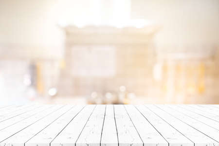 Perspective white wooden table on top over blur background. Can be used mock up for montage products display or design layout.