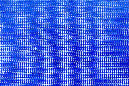 Close up details the surface of the blue plastic sheet. Фото со стока