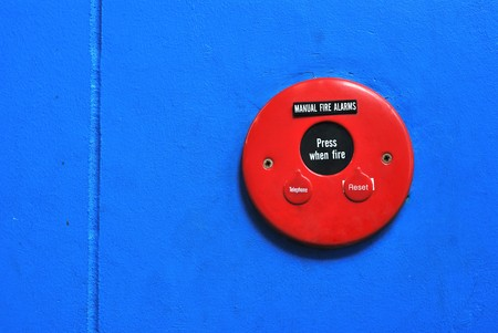 Red Fire Alarm Bell sign  on the blue wall 1