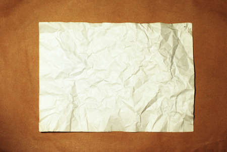 old crumpled paper on brown background Stock Photo - 8188296