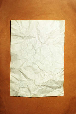 old crumpled paper on brown background