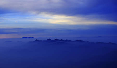Morning Mist at Tropical Mountain Range, Chiangmai,Thailand photo