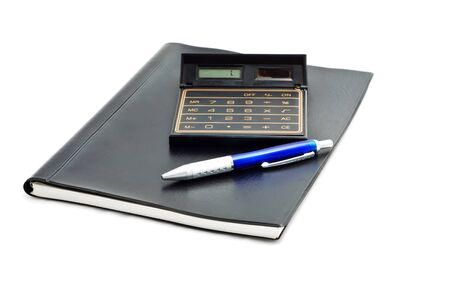 notebook whit pen and calculator isolated on white