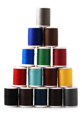 spools of colour threads isolated on white