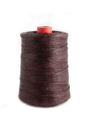 fibrous: Colorful thread in spool isolated on white background Stock Photo