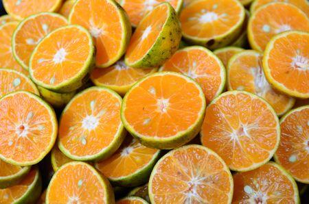 Fresh orange fruits slices background