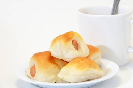Sausage dough and coffee cup photo