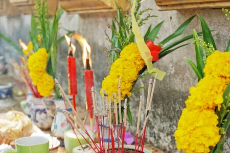 Burning Candle and flower for worship photo