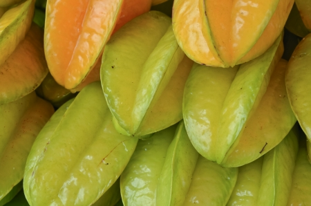 pile of tropical fruit or Carambola fruit was managed