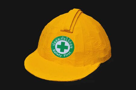 Yellow Helmet Isolated On Black Background Stock Photo - 16657112
