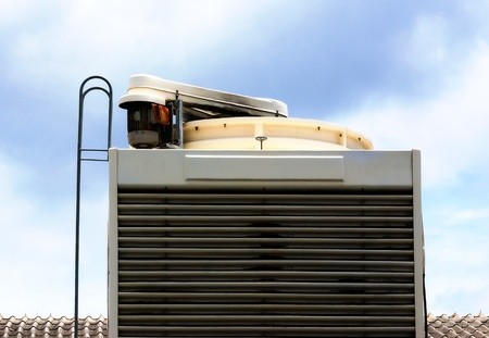 Industrial air conditioning unit cooling system on the roof of a building Stock Photo - 18008105