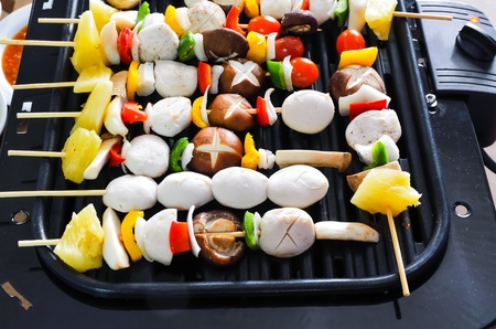 Tasty barbecue meatballs on the grill Stock Photo - 21896607