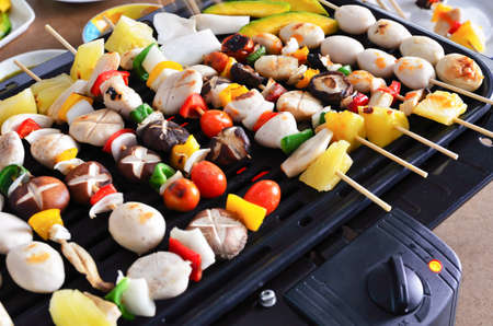 Tasty barbecue meatballs on the grill Stock Photo - 21896608