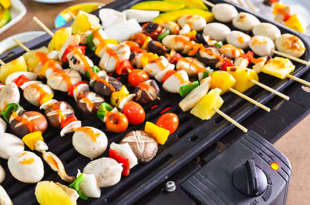 Tasty barbecue meatballs on the grill Stock Photo - 21896609