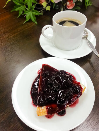 Cake blueberry with coffee cup in background Stock Photo - 24055258