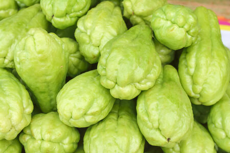 Pile chayote fresh vegetables on the market Stock Photo