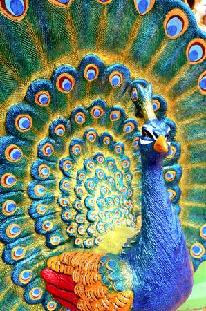 Colorful peacock statue at Kanchanaburi, Thailand  Stock Photo