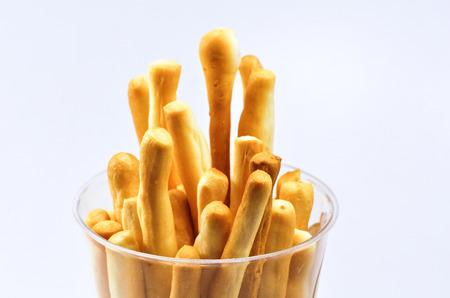 crispy bread sticks on white background