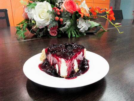 Blueberry cheese cakes in white plate