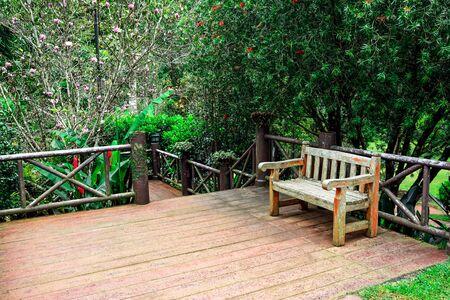 Beautiful wooden garden chair in the garden Stock Photo