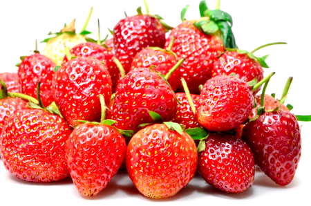 Ripe red strawberries on white background