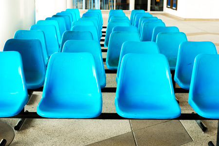 Row of Empty blue plastic chairs  Empty blue seat