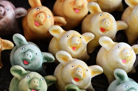 Pig statues laugh