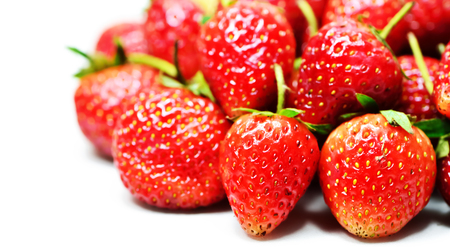 Red strawberries on white background Stock Photo