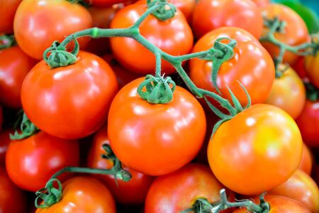 Ripe red tomatoes in the market Stock Photo