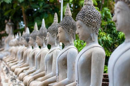 many buddha statue sit on base front. Stock Photo